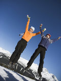 Jumping Boy and Girl at Ski Area