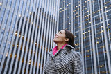 Woman Looking Up at Skyscrapers