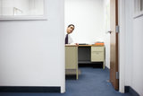 Businessman Peeking Out from Office