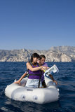 Couple with map on dingy boat