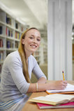 Portrait of young woman in library