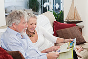 Senior couple looking at travel brochure
