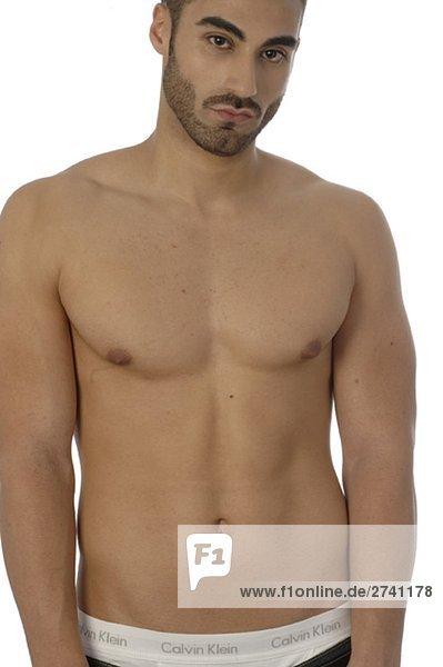 Junger Mann mit freiem Oberkörper - Lizenzfreies Bild