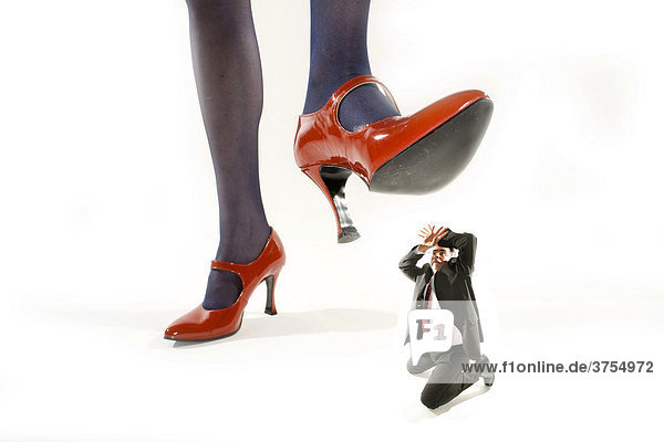 Woman Stepping On Man Woman in red high heel...