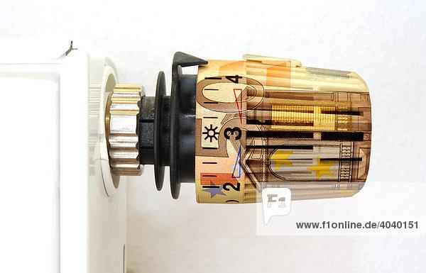 heizk rper ventil regler mit 50 euro schein als symbolbild f r steigende energiekosten. Black Bedroom Furniture Sets. Home Design Ideas