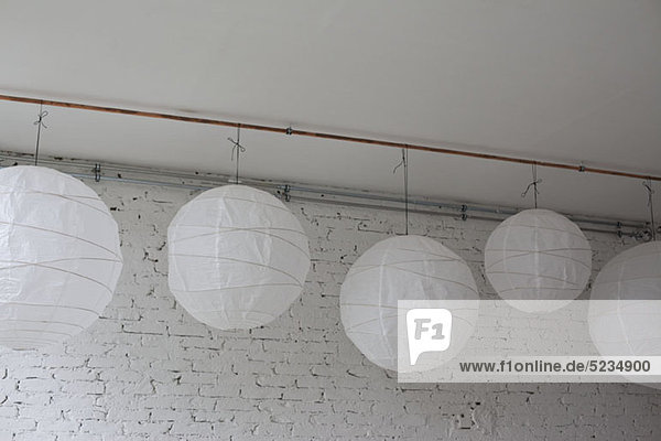 Five white round paper lanterns hanging in a row royalty - White hanging paper lanterns ...