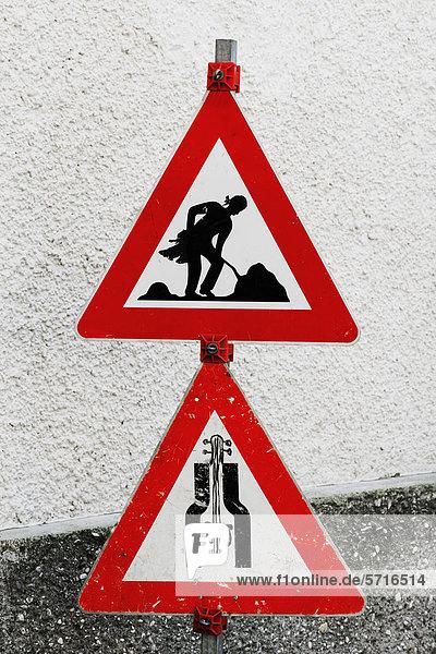 Baustellenschilder sicherheit  Europa, Mozart als Bauarbeiter, Salzburg, Violine statt ...