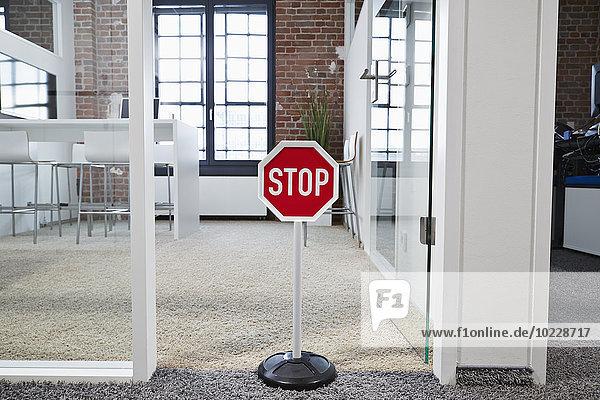 stop sign in modern open plan office