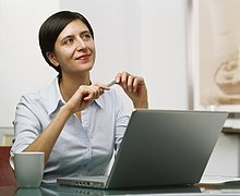 Businesswoman at desk with laptop computer