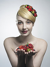 Woman holding handful of fruit