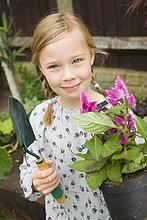 Außenaufnahme,Blume,lächeln,Mädchen,freie Natur,anpflanzen