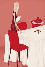 Schöne Frau deckt den Abendbrottisch