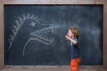 Junge - Person,Zeichnung,jung,rufen,Schreibtafel,Tafel,Dinosaurier