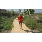 Mature woman jogging on a path
