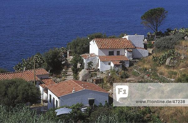 Houses on cliff at coast  Chiessi  Elba  Italy