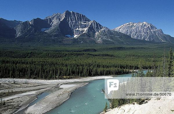 River flowing through landscape with mountain range in background  Icefields Parkway  Alberta  Canada