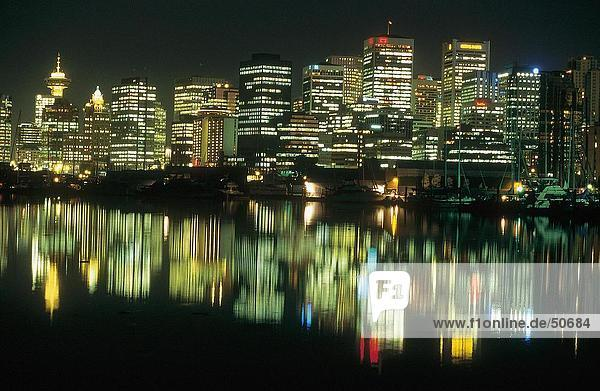 Buildings lit up at night  Vancouver  British Columbia  Canada