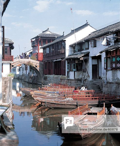 China  Zhouzhuang  Jiangsu  Boats moored by houses in river