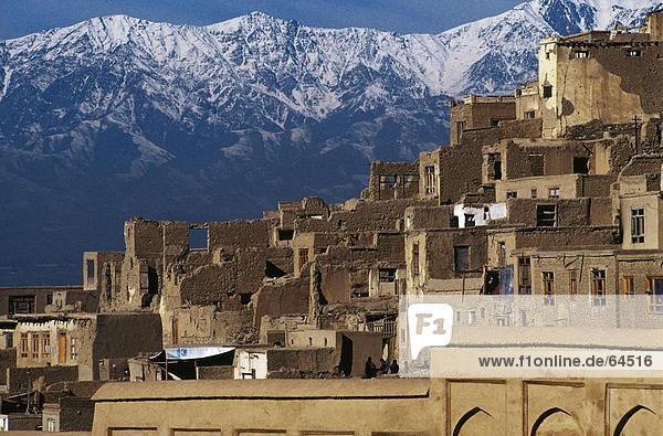 Houses in city against mountain range  Kabul  Afghanistan