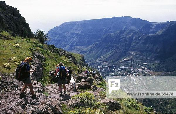 Group of hikers on a downward trail  La Gomera  Canary Islands  Spain