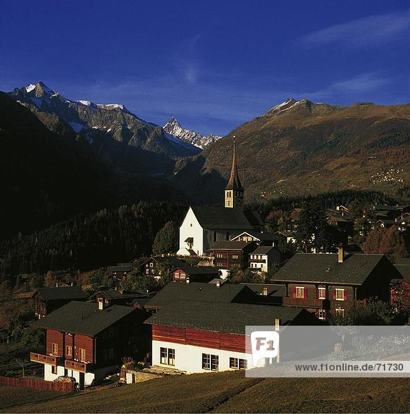10136393  mountain landscape  village view  Ernen  facades  houses  homes  church  Switzerland  Europe  Valais