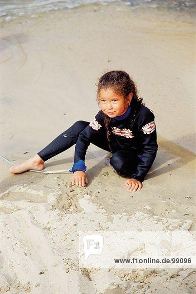Children. Girl. Beach. Swimwear. Wetsuit