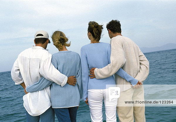 Two couples at the seaside