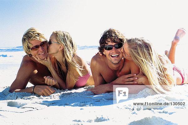 Romantic women and men on beach