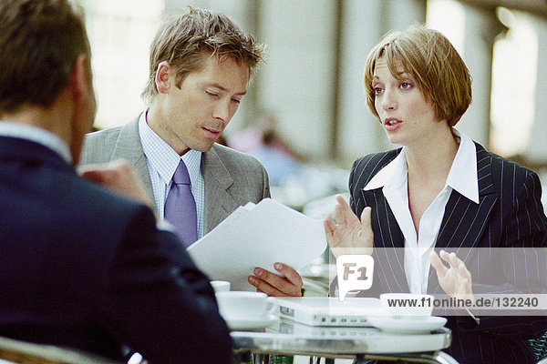Businesspeople having meeting at cafe
