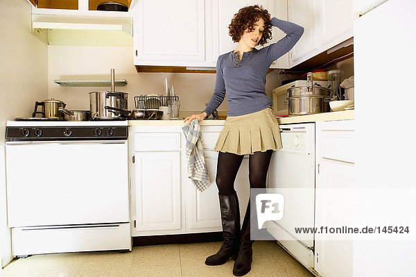 Worried looking woman in kitchen