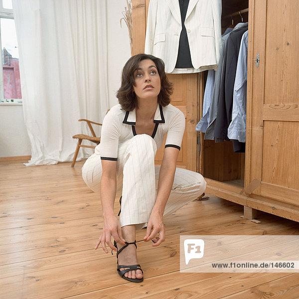 Woman lacing up sandal