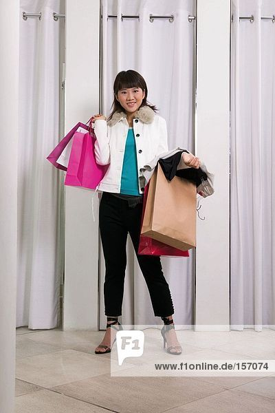 Young woman in clothes store