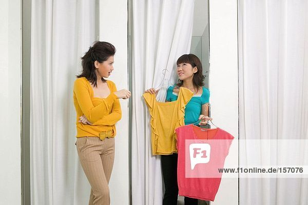 Two women in clothes store
