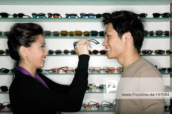Young couple shopping for eyeglasses