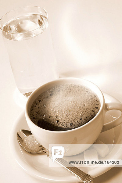Coffee and glass of water