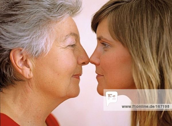 Grandmother and granddaughter face to face  close-up