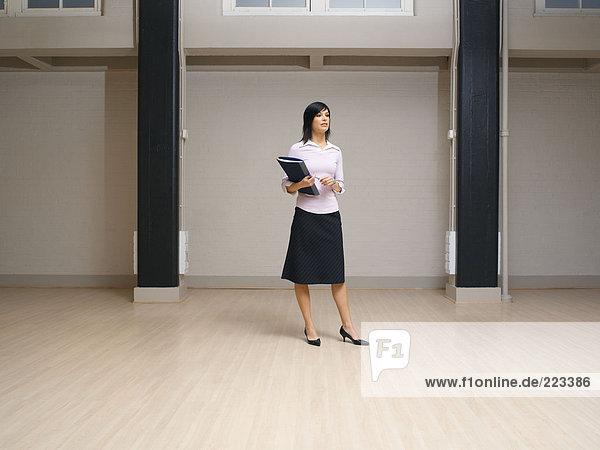 Woman in an empty office space