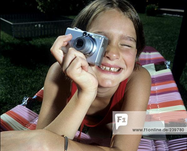 portrait of girl having fun with digital camera