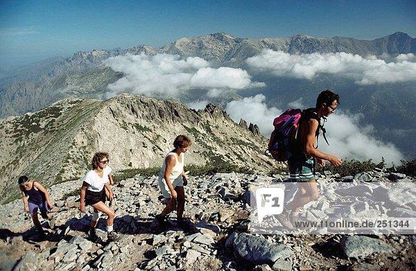 10164426  mountains  mountainous region  group  Corsica  backpacks  trekking  mountain walking  walking  hiking  traveling hol