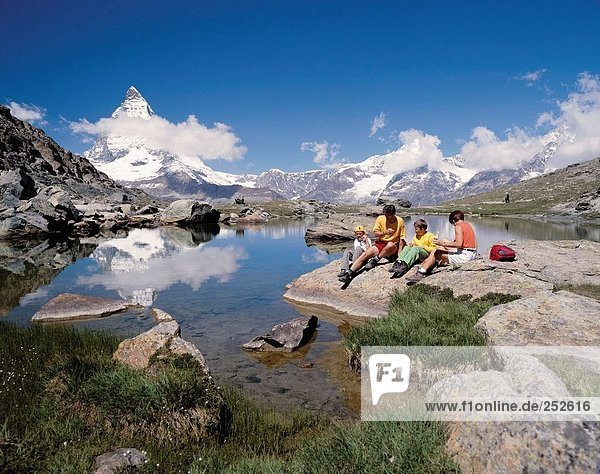 10514014  mountain walking  Alps  mountains  family  canton Valais  Matterhorn  landmark  mountain  Switzerland  Europe  picni