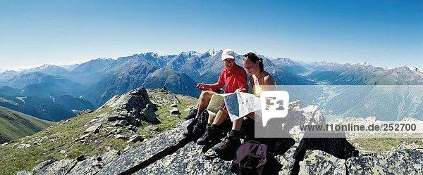 10635488  mountain walking  Alps  mountains  Engadine  Lower Engadine  mountain wandering  Graubunden  Grisons  pair  couple