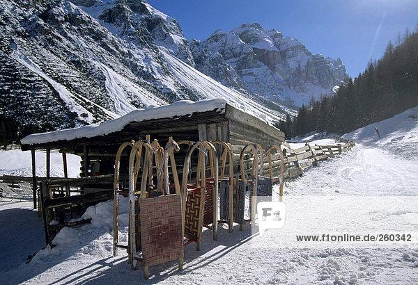 Austria  Tirol  Stubai valley  sledges in front of lodge