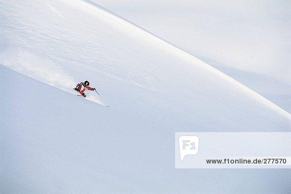 A skier in a ski slope.