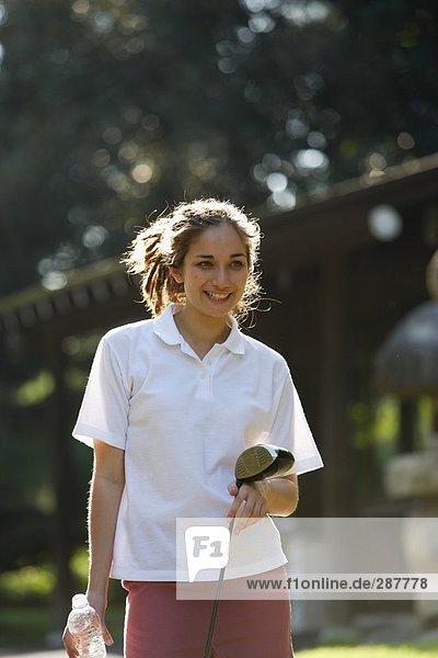 Female golfer smiling