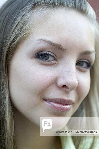 portrait of mischievous looking young woman