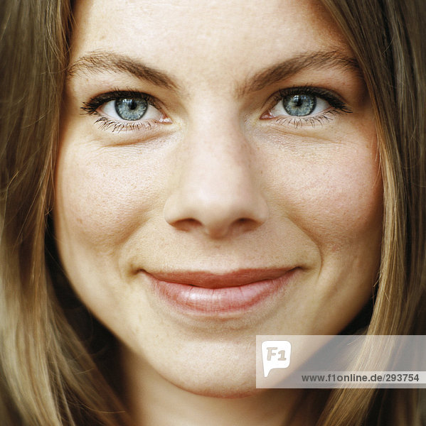 Close-up of a smiling woman's face.