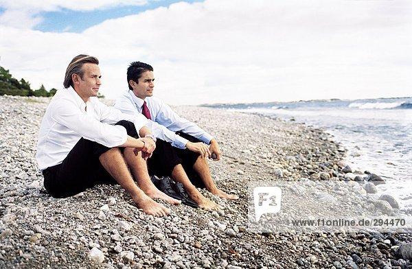 Businessmen on a beach.
