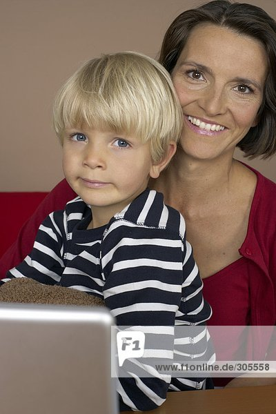 Portrait of mother and son (4-5 Years)