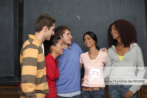 A multi ethnic group in front of a blackboard  selective focus