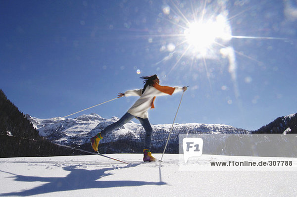 Woman cross-country skiing  side view